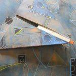 Falter in Leder mit Metall und Spiegel